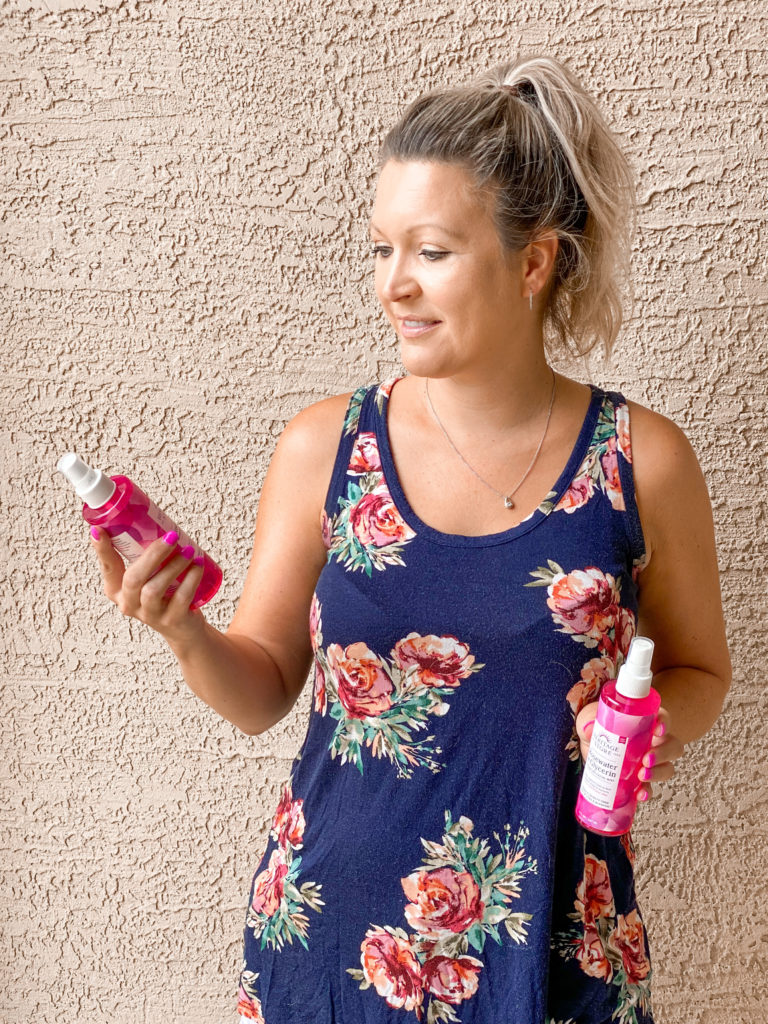 Woman holding skincare product